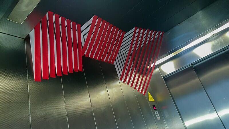 3d tape art in elevator- left side