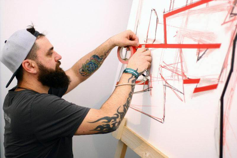 Artist Slava Ostap at work- Making of tape art