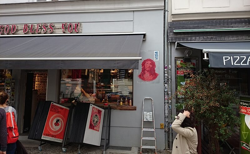 Jesus Visa Card- stencil street art by Ostap- Kastanienallee Berlin