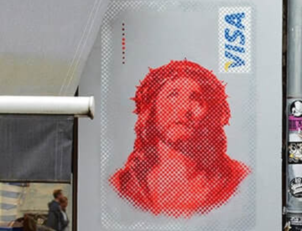 """Jesus VISA"" – street art in Berlin"