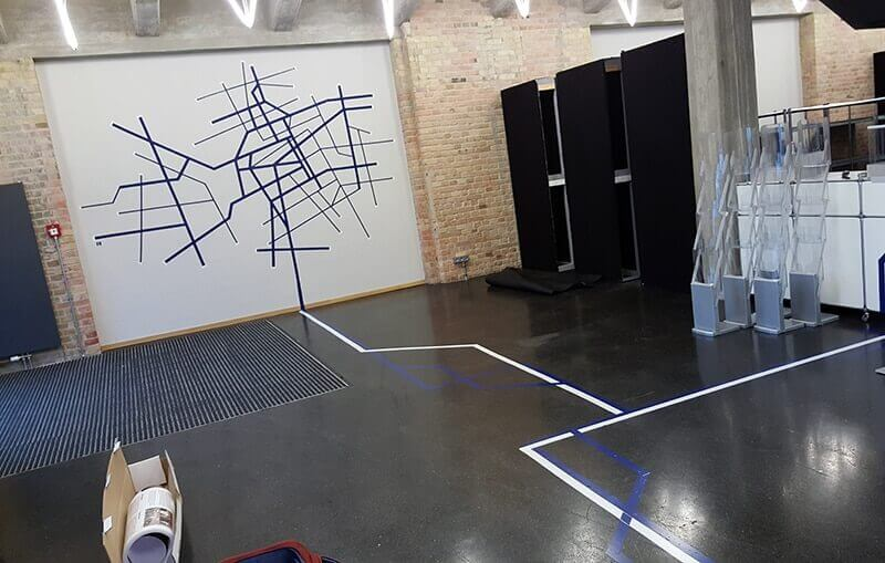 """Photo of tape art room design by """"SELFMADE CREW"""" for BMBF Event- City map"""