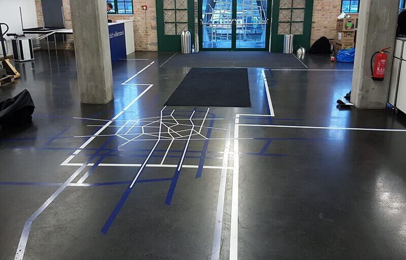 Image of duct tape route guidelines on BMBF event- Entrance area