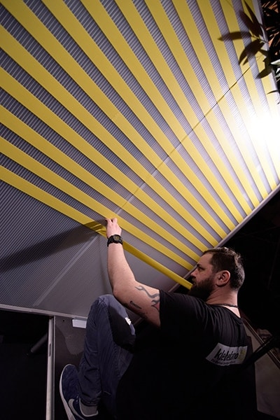 Tape artist Slava Ostap at work in Stuttgart