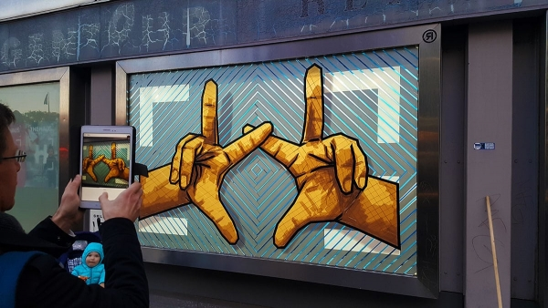The Hands-the haus- brown packing tape street art by Selfmadecrew