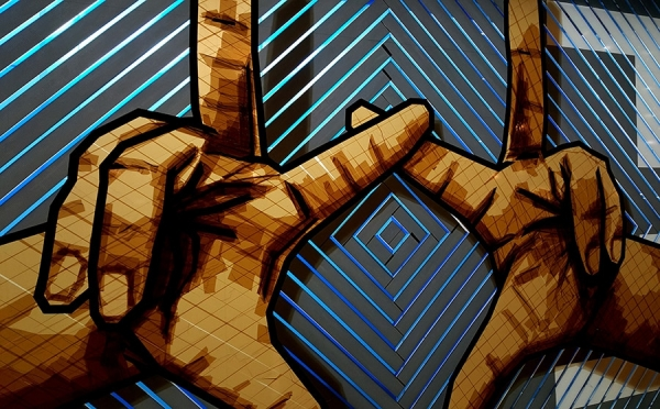 The Haus- hands-brown packing tape street art piece by Selfmadecrew-closeup