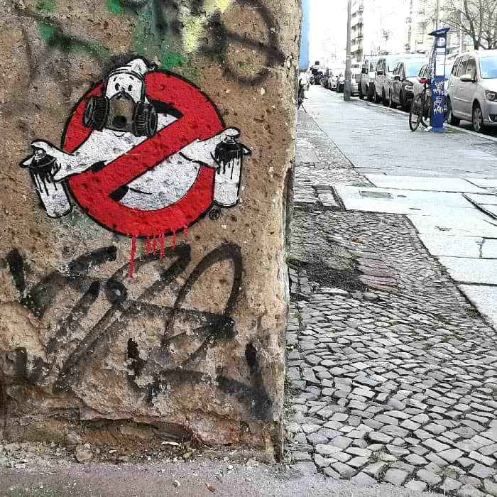 Stencil street art by Ostap artist and Selfmadecrew- Graffitibusters Logo